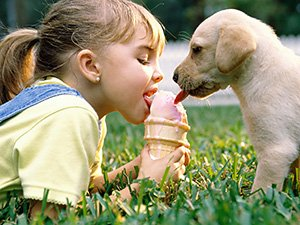 sharing ice cream wiht the puppy